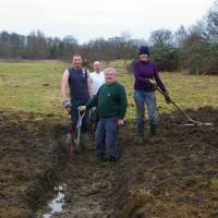 Wicksteed Park water meadow restoration Turf cutting & initial scrub clearing